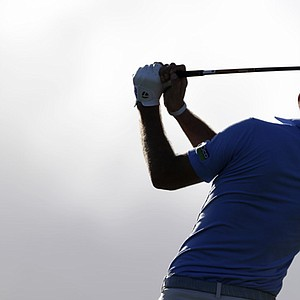 Dustin Johnson tees off on the fourth hole during the third and final round at the Hyundai Tournament of Champions.