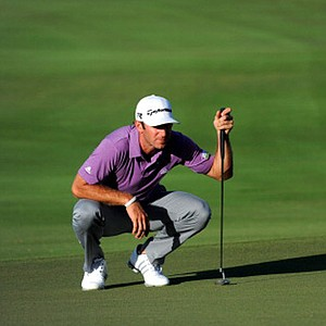 Dustin Johnson studies his putt on the 16th hole during the second round of the Hyundai TOC.