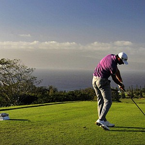 With a beautiful backdrop, Dustin Johnson hits a drive on the 17th hole during the second round of the Hyundai Tournament of Champions.