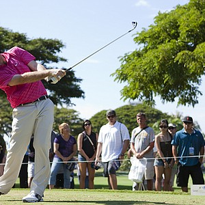 Russell Henley drives off the fourth tee during the final round of the Sony Open in Hawaii.