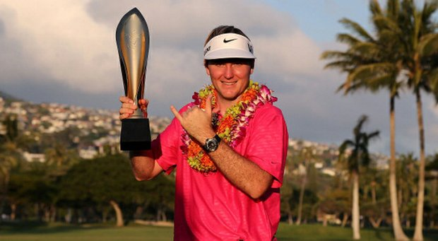 Rookie Russell Henley poses with the Sony Open trophy.
