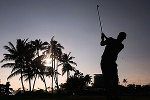 Russell Henley hits a tee shot on the 17th hole during the thrid round of the Sony Open in Hawaii.