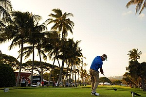 Russell Henley hits a drive on the 18th hole during the third round of the Sony Open in Hawaii at Waialae CC.