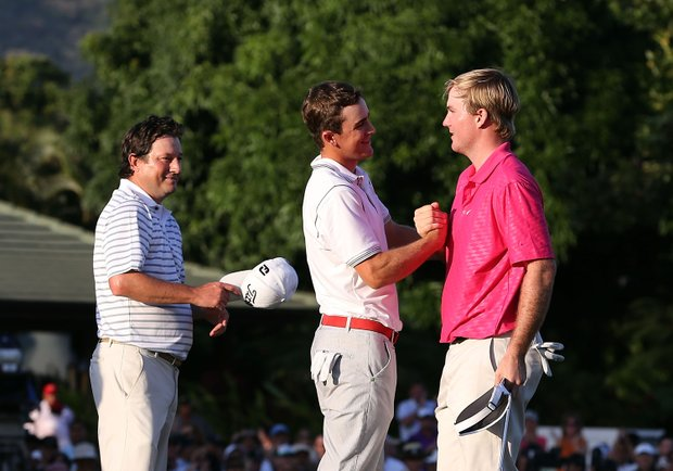 Russell Henley (right) is congratulated by Scott Langley (center) and Tim Clark (left) after Henley won the Sony Open.