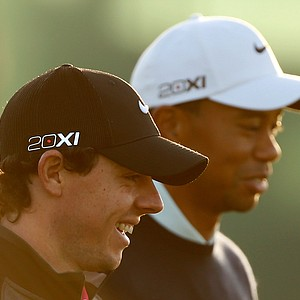 Rory McIlroy and Tiger Woods walk up the fairway on the 10th hole during the first round of the Abu Dhabi HSBC Golf Championship.