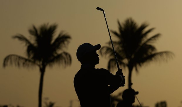 Tiger Woods watches his approach shot on the 10th hole during the first round of the Abu Dhabi HSBC Golf Championship.