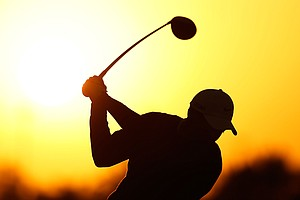 Tiger Woods hits a shot on the practice ground before the start of the first round of the Abu Dhabi HSBC Golf Championship.