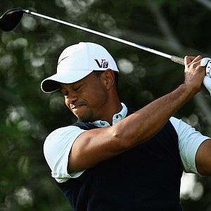 Tiger Woods looks on after his tee shot on the 12th hole during the first round of the Abu Dhabi HSBC Golf Championship.