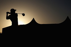 Rory McIlroy hits his tee shot on the first hole during the first round of The Abu Dhabi HSBC Golf Championship.