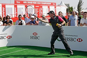 Rory McIlroy plays tennis in the spectator village during the first round of the Abu Dhabi HSBC Golf Championship.