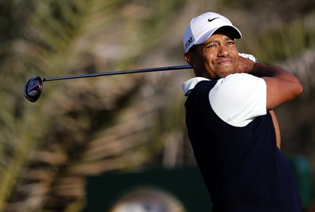 Tiger Woods will play with Rory McIlroy and Martin Kaymer in the second round, with a 3:05 a.m. EST tee time expected.