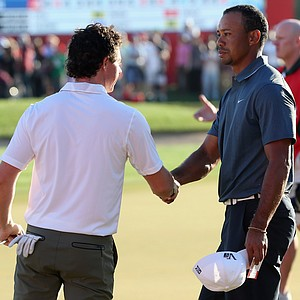 Rory McIlroy and Tiger Woods shake hands on the 18th hole during the second round of The Abu Dhabi HSBC Golf Championship.