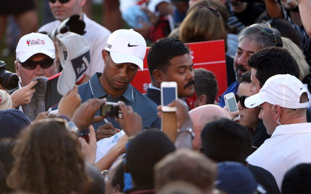 Tiger Woods signs autographs after his round during the second round of the Abu Dhabi HSBC Golf Championship.