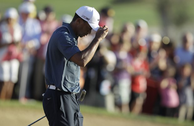 Tiger Woods reacts to fans after he finished the second round of Abu Dhabi Golf Championship.