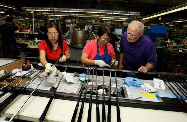 John Solheim with a pair of employees at the Ping headquarters in Phoenix, Ariz.