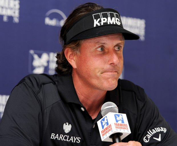 Phil Mickelson reacts to questions during his media interview after his pro-am round for the Farmers Insurance Open.