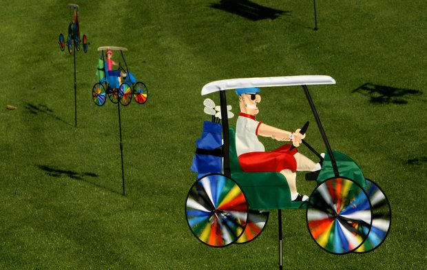 "The ""Man in Golf Cart"" Wind Spinner is sold by Name it Golf, Inc."