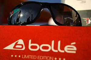 A reflection of people and banners show up in the lens of sunglasses at  Bollé, which is offering this and two other limited-edition glasses that benefit the Folds of Honor.