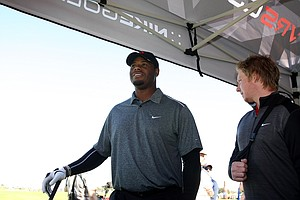 Ken Griffey Jr. waits his turn to hit balls during the Nike Golf VRS Covert Distance Challenge at Demo Day.