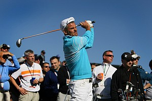 Jesper Parnevik hits balls at the Cobra Puma Golf area at Demo Day.