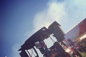 DJ Scotty spins tracks at the Cobra/Puma Golf station during Demo Day.