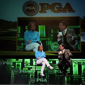 Annika Sorenstam talks with Jimmy Roberts on stage about growing the game during the 2013 PGA Merchandise Show.