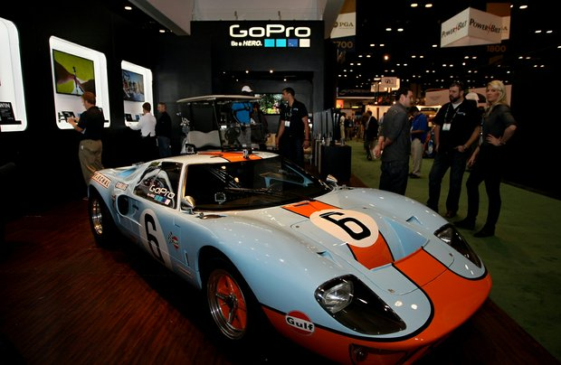 A Ford GT is displayed in the GoPro booth with GoPro Hero 3 cameras attached to several areas of the car during the 2013 PGA Merchandise Show.