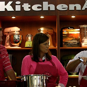 PGA Tour memeber Carl Pettersson with his wife DeAnna cook at the KitchenAid booth during the 2013 PGA Merchandise Show.
