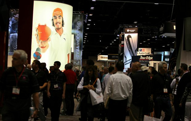 A giant photo of Rickie Fowler hangs outside the Cobra Puma booth during the 2013 PGA Merchandise Show.