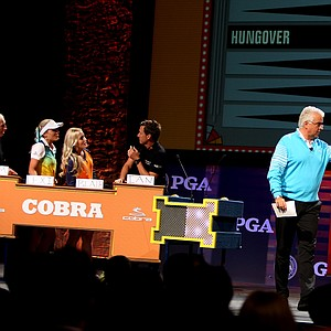 """Actor John O'Hurley has a little fun with some of the Cobra Puma Golf celebs during the """"Golf Feud"""" on the PGA Forum stage."""
