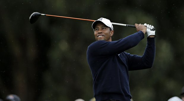 Tiger Woods watches his tee shot on the 15th hole of the North Course at the Torrey Pines during the second round of the Farmers Insurance Open.