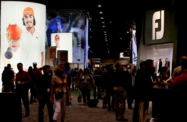 Members of the golf industry roam the floor during the second day of the PGA Merchandise Show.