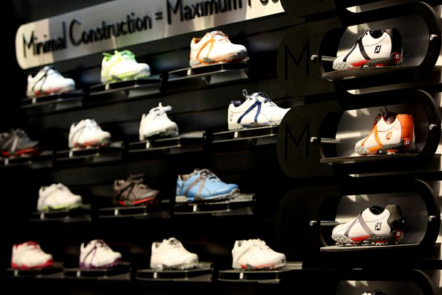 FootJoy's new M Project shoes, which feature a minimalist design and are available with spikes or without, are on display.