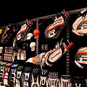 TaylorMade golf bags and accessories are on display on the show floor.