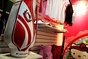 Hello Kitty shows golf bags and a variety of other accessories on display at the 2013 PGA Merchandise Show.