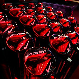 Nike's Covert drivers, fairway woods and hybrids show up as a dramatic red under the styled lighting in Nike's booth on the show floor.