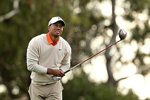 Tiger Woods watches his tee shot on the 15th hole during the first round of the Farmers Insurance Open on the South Course at Torrey Pines.