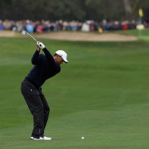 Tiger Woods plays his second shot from the 14th fairway at Torrey Pines North Course during the second round of the Farmers Insurance Open.