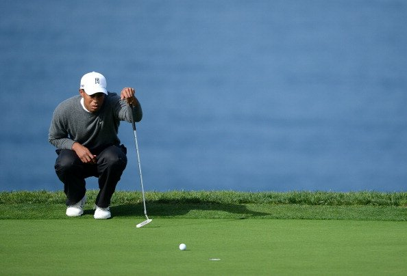 Tiger Woods studies the green on No. 7 during the third round of the Farmers Insurance Open.