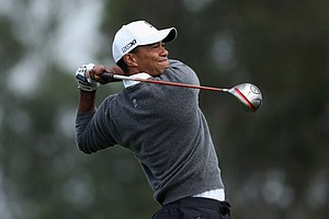 Tiger Woods hits a tee shot on the ninth hole during the third round of the Farmers Insurance Open at Torrey Pines.