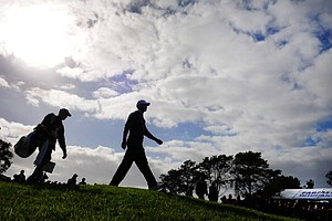 Tiger Woods walks to the 18th fairway during the third round of the Farmers Insurance Open.