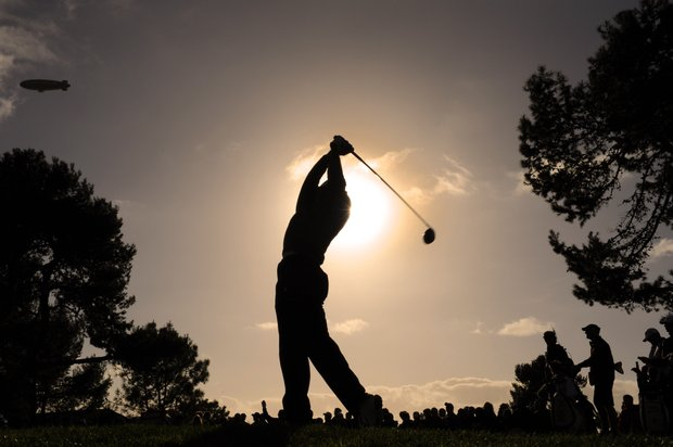 Tiger Woods hits a drive on the second hole during the final round of the Farmers Insurance Open.
