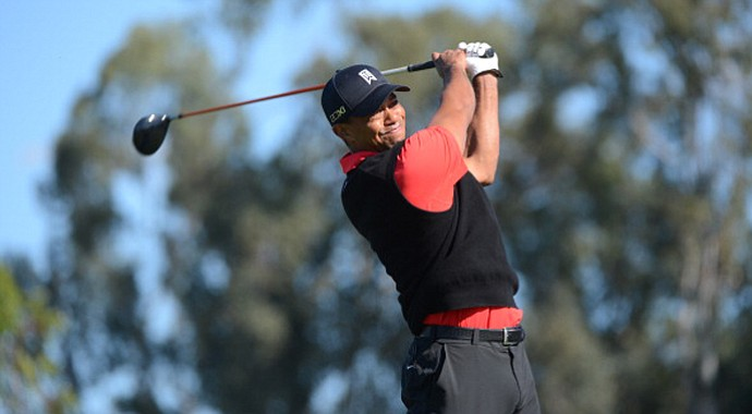 Tiger Woods hits off the 9th tee during the final round at the Farmers Insurance Open at Torrey Pines.
