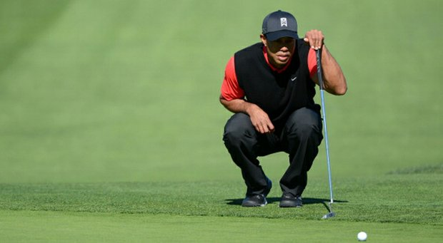 Tiger Woods studies the 9th green during the final round at the Farmers Insurance Open at Torrey Pines Golf Course.