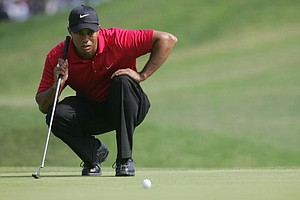 Tiger Woods lines up a putt on No. 4 during the playoff round of the 108th U.S. Open Championship.