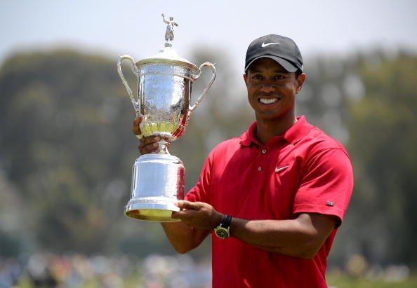 Tiger Woods holds his trophy after defeating Rocco Mediate in the sudden death playoff at the 108th U.S. Open Championship.