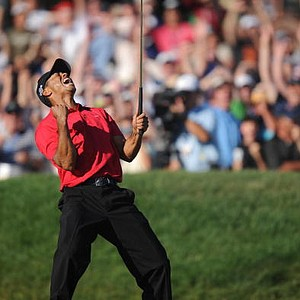 Tiger Woods celebrates his birdie putt on the 18th hole in the fourth round of the 108th U.S. Open. Woods finished tied for the lead with Rocco Mediate, forcing a playoff which took place on Monday, June 16.