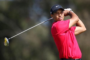 Tiger Woods hits a shot during the final round of the 108th U.S. Open at the Torrey Pines.