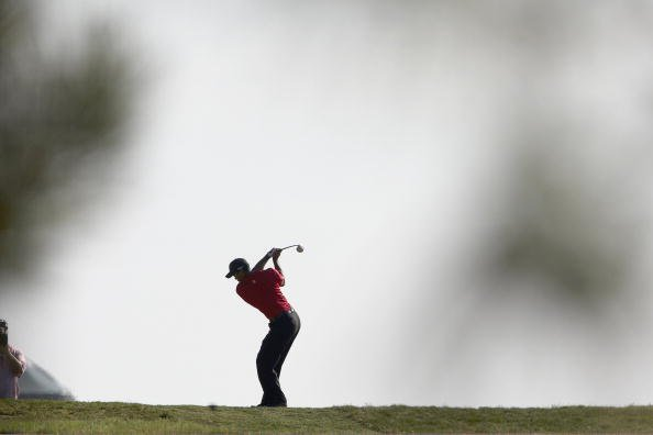 Tiger Woods hits a drive on Sunday at Torrey Pines GC.