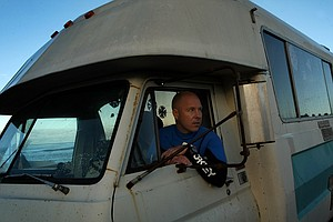 Dave Ortley with Oakley's Footwear and Accessories Division in his surfing mobile.